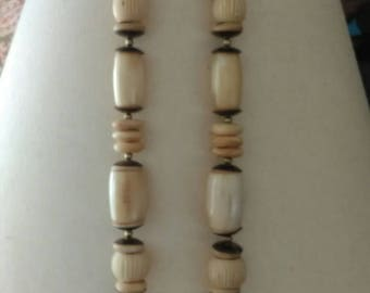Vintage cream and brass separators between beads necklace