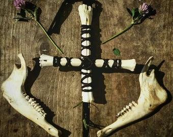 Inverted deer bone cross