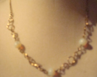 Vintage Sarah Coventry gold tone necklace with milky beads