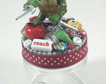 Assemblage Art Trinket Party Favor Jar  --  Teenage Mutant Ninja Turtle Raphael