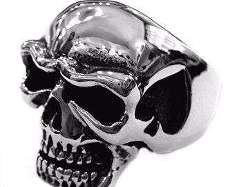 Skull ring and a handmade steel Spades