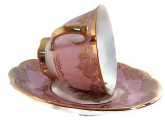 """Vintage Royal Albert """"violet"""" pattern footed tea cup with a pink/lavender background with heavy gold accents"""