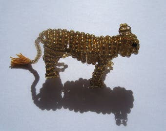 Miniature lioness seed beads and copper wire