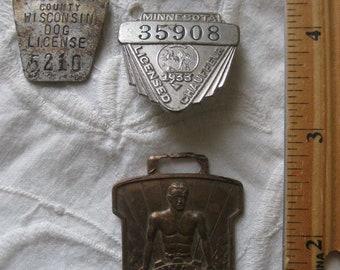 four antique tags