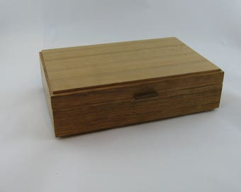Jewelry box in cherry wood  12 X 7 3/4 x 3 1/4 .Top is made from vertical grain ( quarter cut )