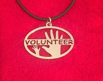 Volunteer pendant, Volunteers Necklace,All hands volunteer, voluntarios, bénévoles, Freiwillige, surgical SS pendant,