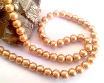 Wholesale lot of 800 gold glass pearl beads, 8mm