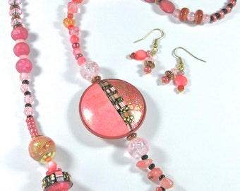 Asymmetrical pink necklace with handmade beads