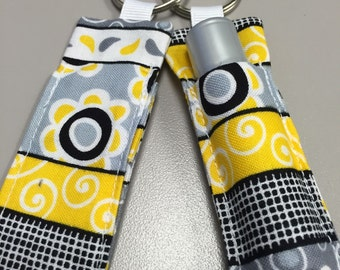 Yellow and black quilt fabric lip balm /chapstick holder keychain.