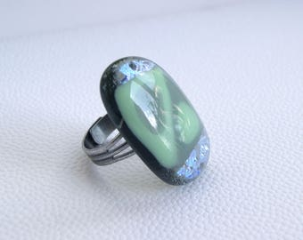 Adjustable olive green ring with a spark of dichroic