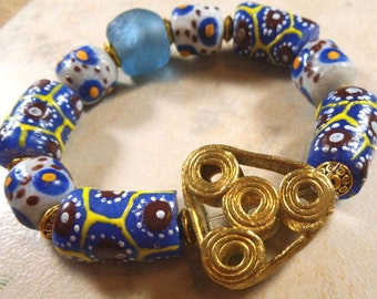 Chunky African bracelet of blue Krobo beads from Ghana with brass focal bead and recycled blue glass - AB180