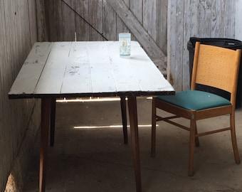 Barn door dining table with Danish Modern Walnut legs Uber chic