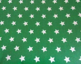 Laminated cotton fabric stars green 50 x 70 cm