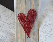 String art red heart on r...