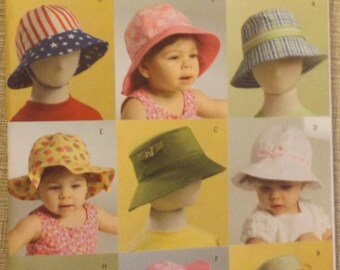 Butterick B5056 Sewing Pattern Infants'/Toddlers' Hats in Sizes XS through XL Uncut/FF Complete