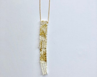 Hand woven piece with gold leaf necklace
