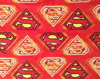Flannel/Licensed/Superman emblem on red background cotton by the yard