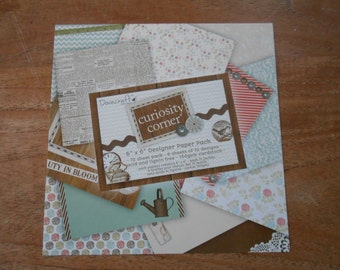 "Dovecraft ""Curiosity Corner"" 12 sheets. 6"" x 6"" . 150gsm cardstock. Acid and Lignin Free. Card making. Scrapbooking. Papercrafts."