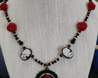 Madame Macabre beaded necklace with skull and bone toggle closure