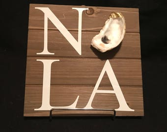 Wooden NOLA Sign with Gold Oyster Accent