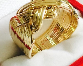 9k   solid gold 12 band puzzle ring