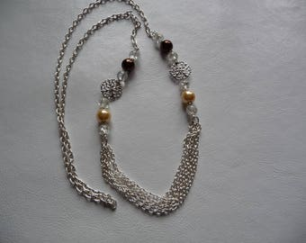 Necklace brown and beige pearls.