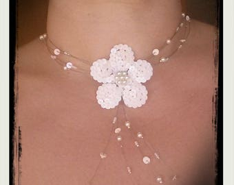 Necklace made with ivory pearls and sequins flower