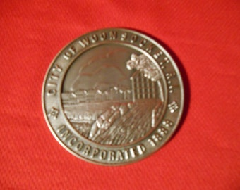 """One (1), Silver Toned, 3"""" Metal Medallion, Celebrating the 100th Anniversary of Woonsocket, RI. 1888-1988."""