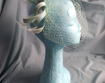 Mint green fascinator with birdcage veil