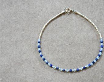 tiny lapis lazuli and fluorite beaded bracelet. thin string like bracelet. gold seed beads. lapis lazuli and fluorite bracelet jewelry