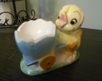 adorable little chick with wheel barrow egg cup holder