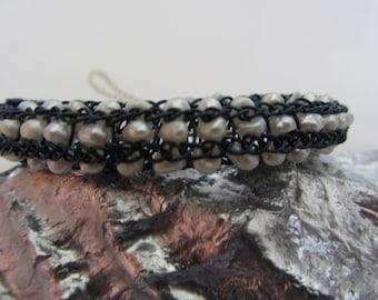 White Fresh water knitted into Navy Blue Bracelet