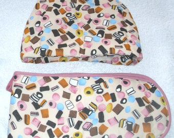 Liquorice Allsorts tossed on pale peach Tea cosy and Oven gloves