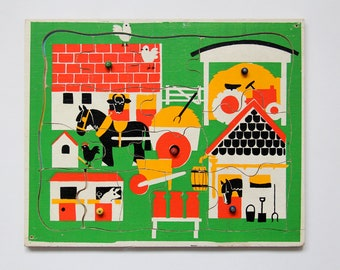 Vintage wooden jigsaw puzzle in stylised farm design with hidden farmyard picture underneath