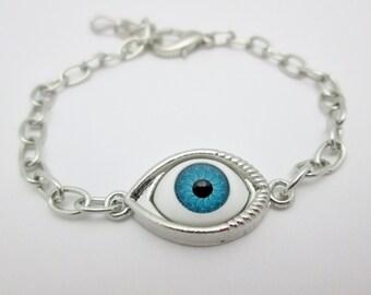 Evil Eye Bracelet (E008). Blue Eyeball Charm Bracelet in Silver Finish.