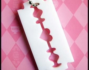 Laser cut acrylic heart razor necklace