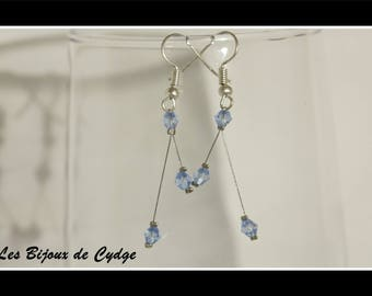 Earrings on twisted wire and its blue bicone bead