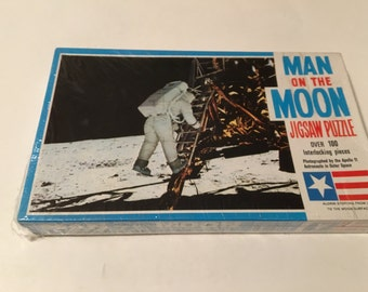 man on the moon jigsaw puzzle buzz aldrin stepping from lm to the moon surface