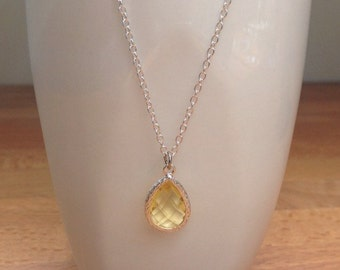 Silver and yellow framed crystal necklace.