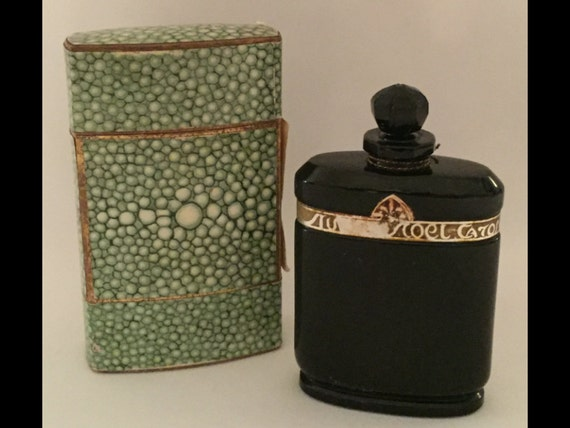 "FREE SHIPPING-Vintage-Caron Nuit De Noel-3"" Tall Bottle With Stopper-Baccarat Bottle-In Original Green Sleve With Lid-Unknown Amount Left"