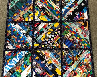 Multi coloured child character baby quilt