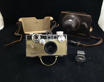 Vintage Argus 35 MM Camera with 50 MM Lens f 3.5 Coated Cintar with Full Leather Case and Argus Light Meter    01701