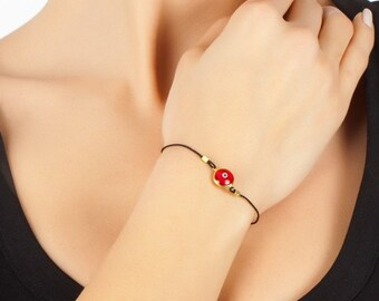 Red Evil Eye Bracelet In Gold Coated Silver with black thread, evileye bracelet