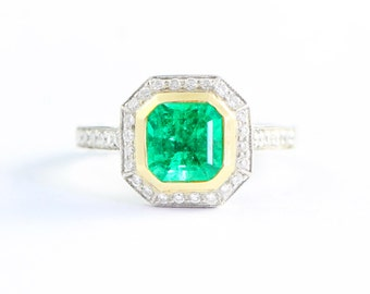 Emerald and diamond square shape art deco style ring in platinum and 18 carat yellow gold