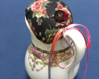 China jug pincushion, pin sharpener.