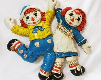 Vintage bobbs merrill raggedy ann and raggedy andy wall decor plaques plastic