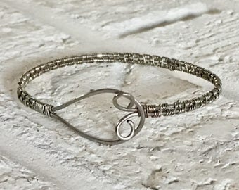 Stainless steel wire wrapped bangle bracelet with loop and hook decorative closure. Sundance inspired.
