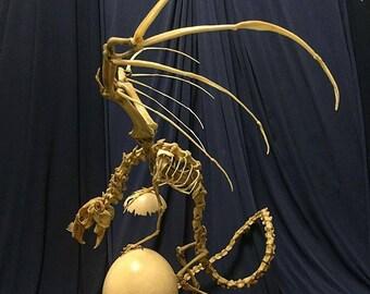 Amaizing Museum exhibit а bone sculpture Cadaver I. The time guardian