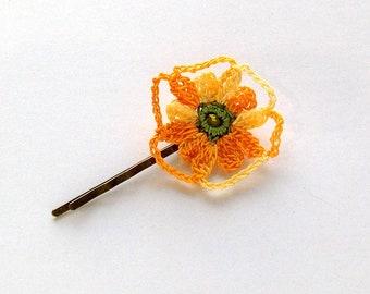 Crocheted, variegated yellow flower motif hair clip.