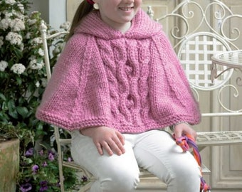 Cape and Sweater knitting pattern for girls knitted in King Cole Super Chunky, sizes from 5 to 13 years, pattern leaflet 3823